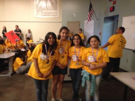 Girls posing with medals